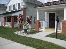 Family entering house in Jeannette